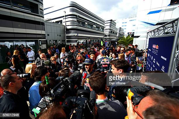 Daniel Ricciardo of Australia and Red Bull Racing talks to the press during practice for the Formula One Grand Prix of Russia at Sochi Autodrom on...