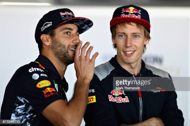 Daniel Ricciardo of Australia and Red Bull Racing talks with Brendon Hartley of New Zealand and Scuderia Toro Rosso on the drivers parade before the...