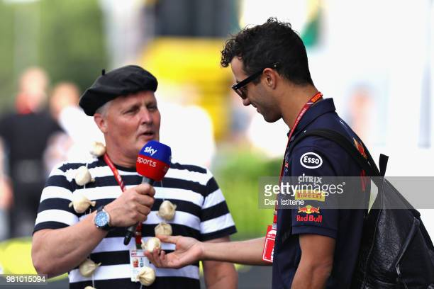 Daniel Ricciardo of Australia and Red Bull Racing talks with Johnny Herbert of Sky Sports in the Paddock before practice for the Formula One Grand...