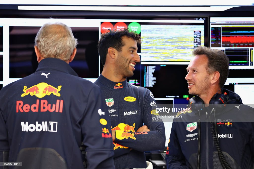 Daniel Ricciardo of Australia and Red Bull Racing talks with Red Bull Racing Team Principal Christian Horner and Red Bull Racing Team Consultant Dr Helmut Marko during final practice for the Formula One Grand Prix of Germany at Hockenheimring on July 21, 2018 in Hockenheim, Germany.
