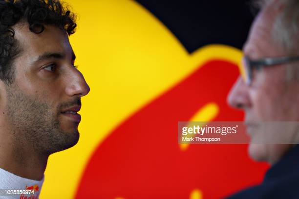 Daniel Ricciardo of Australia and Red Bull Racing talks with Red Bull Racing Team Consultant Dr Helmut Marko in the garage during qualifying for the...