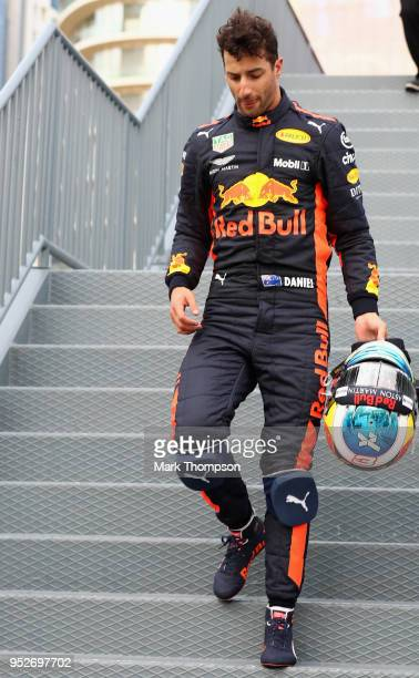 Daniel Ricciardo of Australia and Red Bull Racing walks in the Paddock after retiring from the Azerbaijan Formula One Grand Prix at Baku City Circuit...