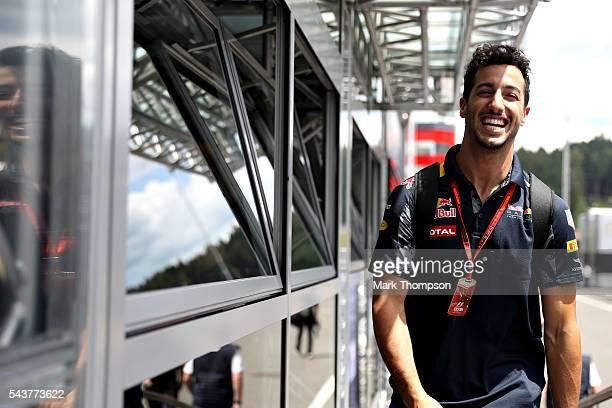 Daniel Ricciardo of Australia and Red Bull Racing walks in the Paddock during previews ahead of the Formula One Grand Prix of Austria at Red Bull...