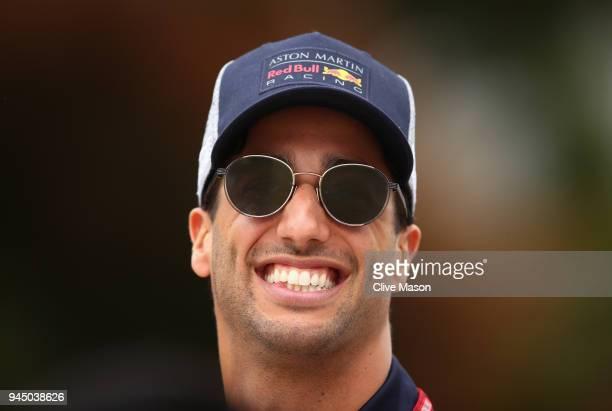 Daniel Ricciardo of Australia and Red Bull Racing walks in the Paddock during previews ahead of the Formula One Grand Prix of China at Shanghai...