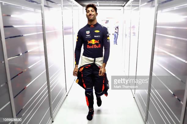 Daniel Ricciardo of Australia and Red Bull Racing walks into the garage during practice for the Formula One Grand Prix of Brazil at Autodromo Jose...