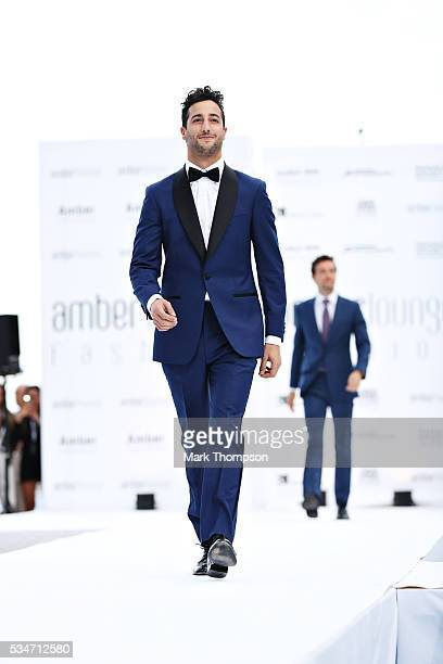 Daniel Ricciardo of Australia and Red Bull Racing walks the catwalk during the Amber Lounge fashion show during previews to the Monaco Formula One...