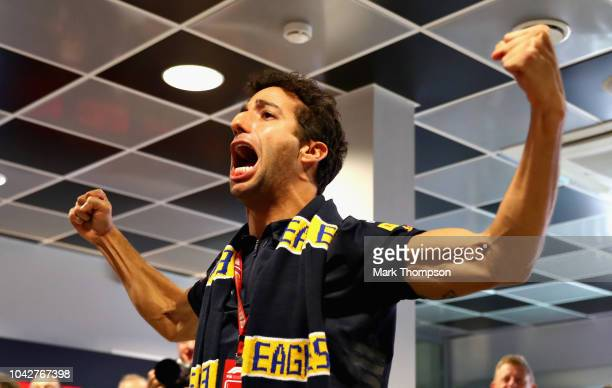 Daniel Ricciardo of Australia and Red Bull Racing watches the action as West Coast Eagles play in the AFL Grand Final before final practice for the...