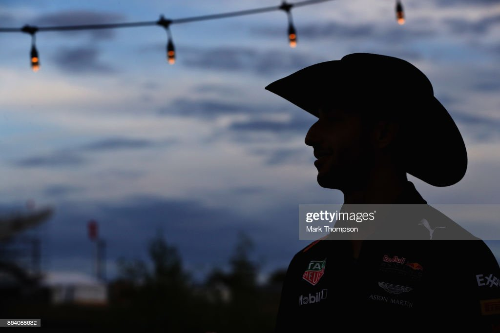 Daniel Ricciardo of Australia and Red Bull Racing wears a cowboy hat after practice for the United States Formula One Grand Prix at Circuit of The Americas on October 20, 2017 in Austin, Texas.