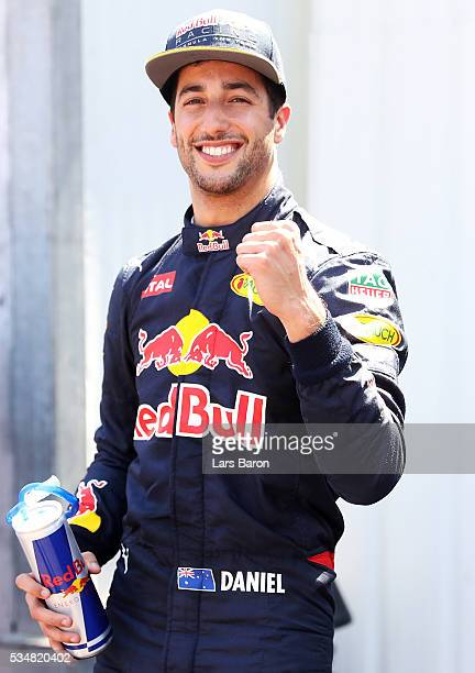 Daniel Ricciardo of Australia and Red Bull RCacing celebrates getting pole position in parc ferme during qualifying for the Monaco Formula One Grand...