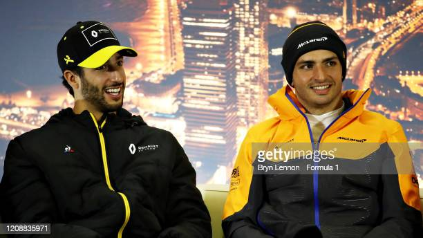 Daniel Ricciardo of Australia and Renault Sport F1 and Carlos Sainz of Spain and McLaren F1 talk in a press conference during Day One of F1 Winter...