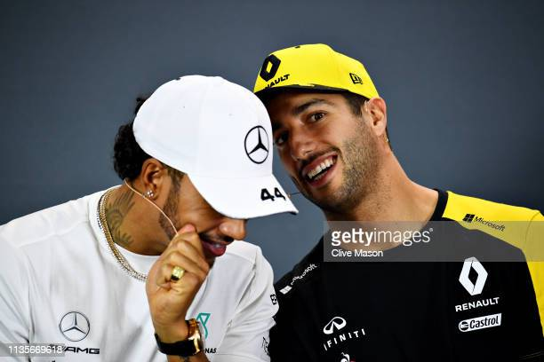 Daniel Ricciardo of Australia and Renault Sport F1 and Lewis Hamilton of Great Britain and Mercedes GP talk in the Drivers Press Conference during...