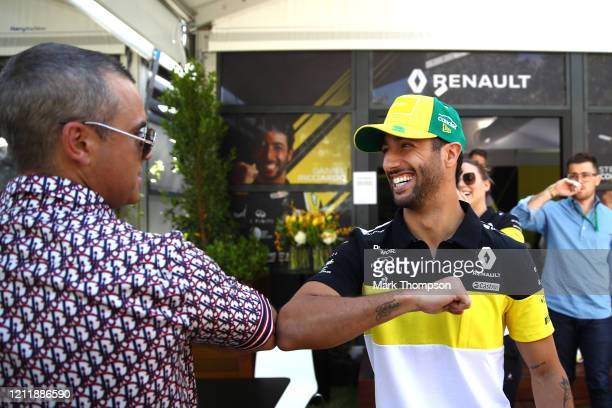 Daniel Ricciardo of Australia and Renault Sport F1 greets Robbie Williams in the paddock during previews ahead of the F1 Grand Prix of Australia at...