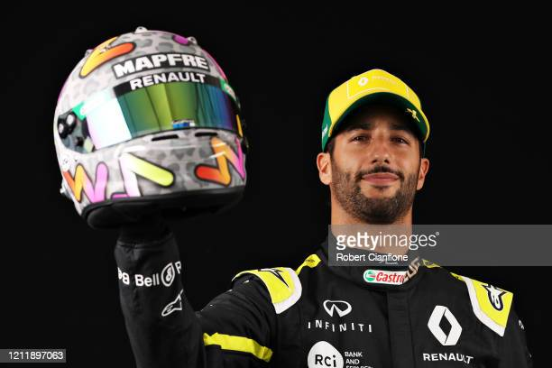 Daniel Ricciardo of Australia and Renault Sport F1 poses for a photo in the Paddock during previews ahead of the F1 Grand Prix of Australia at...