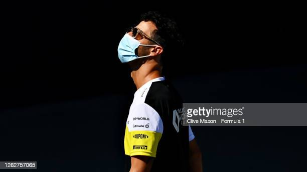 Daniel Ricciardo of Australia and Renault Sport F1 walks in the Paddock during previews ahead of the F1 Grand Prix of Great Britain at Silverstone on...