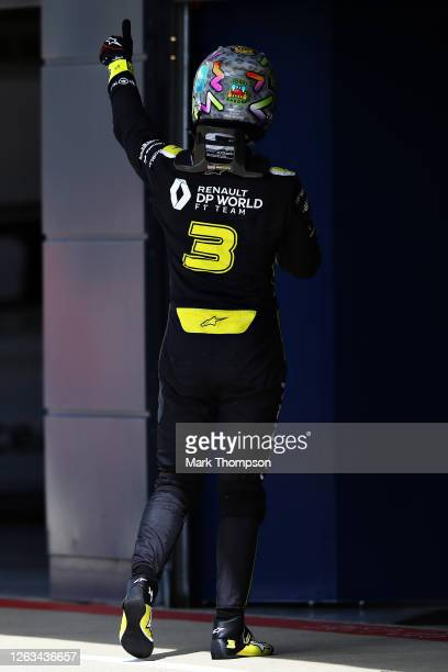 Daniel Ricciardo of Australia and Renault Sport F1 walks into the garage after the F1 Grand Prix of Great Britain at Silverstone on August 02 2020 in...
