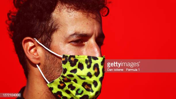 Daniel Ricciardo of Australia and Renault Sport F1 wears a leopard print mask in the Paddock after qualifying for the F1 Grand Prix of Tuscany at...