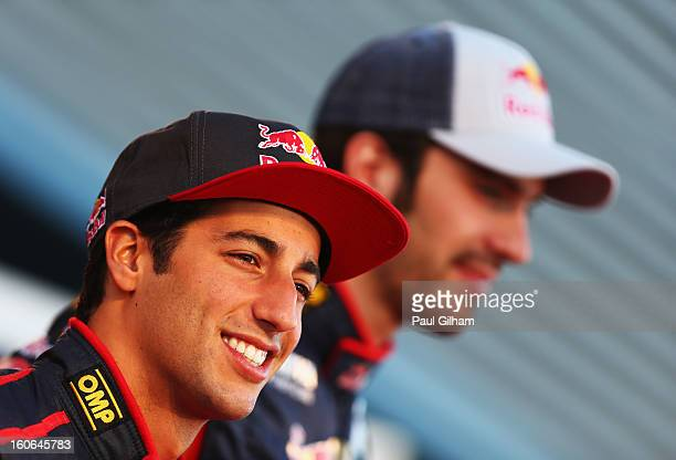 Daniel Ricciardo of Australia and Scuderia Toro Rosso and JeanEric Vergne of France and Scuderia Toro Rosso pose during the Toro Rosso F1 STR8 Launch...