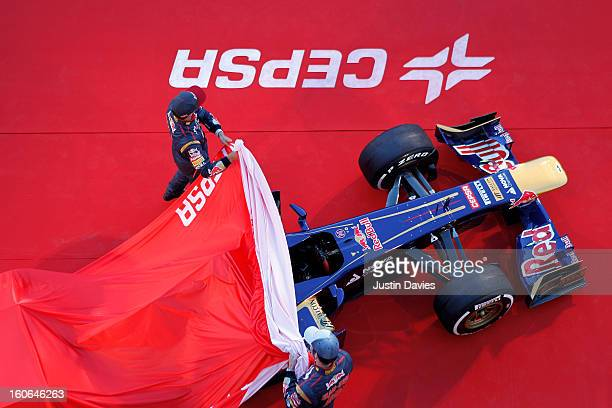 Daniel Ricciardo of Australia and Scuderia Toro Rosso and JeanEric Vergne of France and Scuderia Toro Rosso unveil the new STR8 car during the Toro...