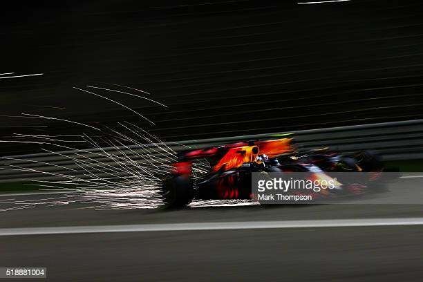 Daniel Ricciardo of Australia drives the Red Bull Racing Red BullTAG Heuer RB12 TAG Heuer goes past Daniil Kvyat of Russia drives the Red Bull Racing...