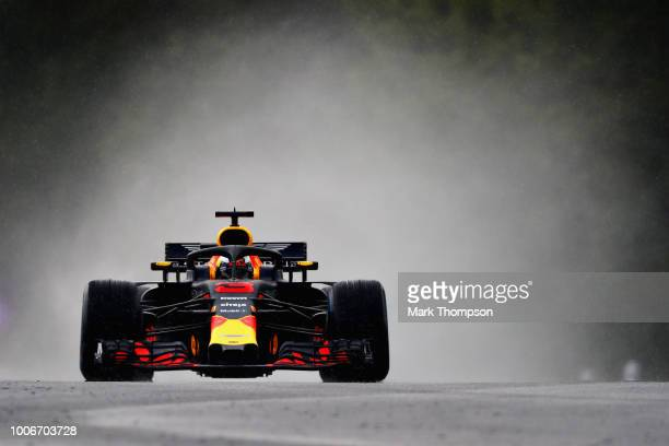 Daniel Ricciardo of Australia driving the Aston Martin Red Bull Racing RB14 TAG Heuer in the wet during qualifying for the Formula One Grand Prix of...