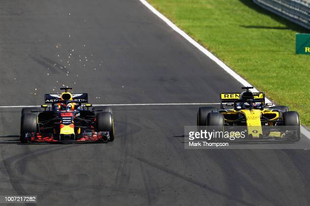 Daniel Ricciardo of Australia driving the Aston Martin Red Bull Racing RB14 TAG Heuer overtakes Nico Hulkenberg of Germany driving the Renault Sport...