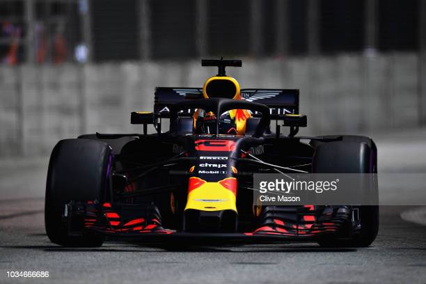 Daniel Ricciardo of Australia driving the Aston Martin Red Bull Racing RB14 TAG Heuer on track during the Formula One Grand Prix of Singapore at...