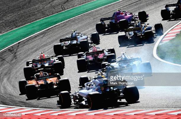 Daniel Ricciardo of Australia driving the Aston Martin Red Bull Racing RB14 TAG Heuer is seen among others at the start during the Formula One Grand...