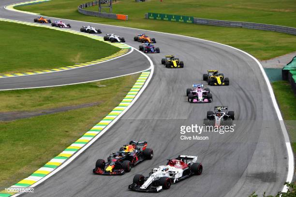 Daniel Ricciardo of Australia driving the Aston Martin Red Bull Racing RB14 TAG Heuer overtakes Marcus Ericsson of Sweden driving the Alfa Romeo...