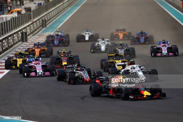 Daniel Ricciardo of Australia driving the Aston Martin Red Bull Racing RB14 TAG Heuer rounds turn one at the start during the Abu Dhabi Formula One...