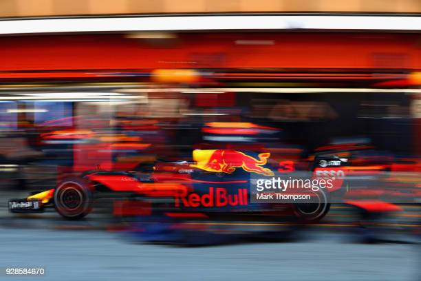 Daniel Ricciardo of Australia driving the Aston Martin Red Bull Racing RB14 TAG Heuer makes a pit stop for new tyres during day two of F1 Winter...