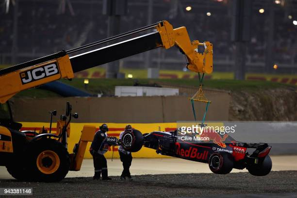 Daniel Ricciardo of Australia driving the Aston Martin Red Bull Racing RB14 TAG Heuer is removed from the circuit after retiring during the Bahrain...