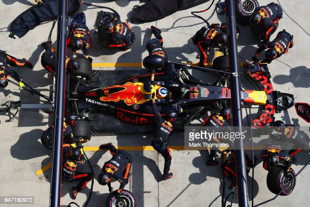 Daniel Ricciardo of Australia driving the Aston Martin Red Bull Racing RB14 TAG Heuer makes a pit stop for new tyres during the Formula One Grand...