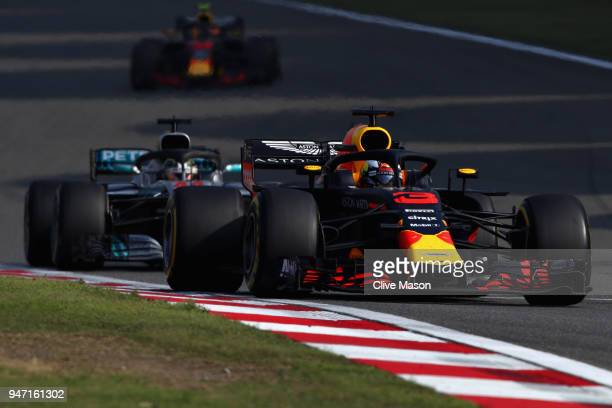 Daniel Ricciardo of Australia driving the Aston Martin Red Bull Racing RB14 TAG Heuer leads Lewis Hamilton of Great Britain driving the Mercedes AMG...
