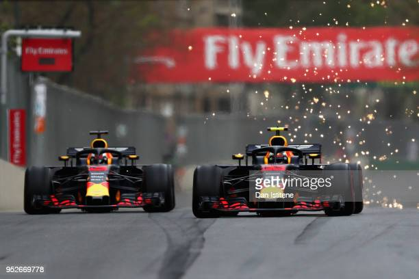Daniel Ricciardo of Australia driving the Aston Martin Red Bull Racing RB14 TAG Heuer and Max Verstappen of the Netherlands driving the Aston Martin...