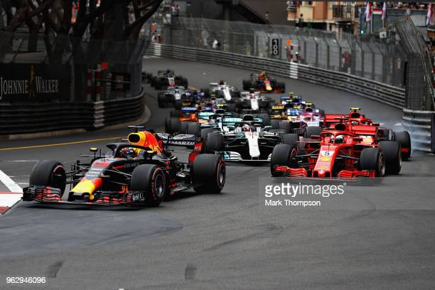 Daniel Ricciardo of Australia driving the Aston Martin Red Bull Racing RB14 TAG Heuer leads the field at the start during the Monaco Formula One...