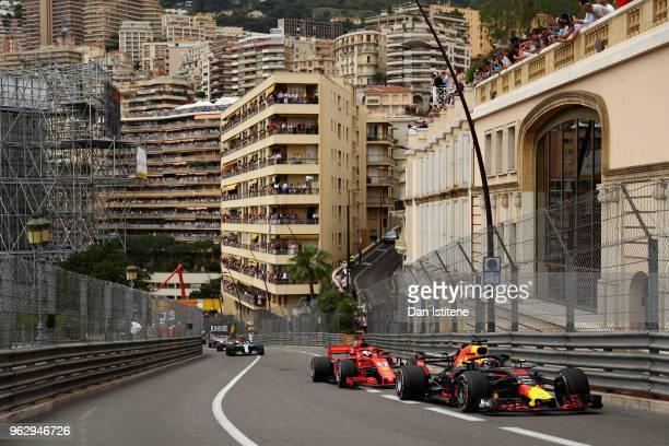 Daniel Ricciardo of Australia driving the Aston Martin Red Bull Racing RB14 TAG Heuer leads Sebastian Vettel of Germany driving the Scuderia Ferrari...