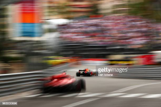 Daniel Ricciardo of Australia driving the Aston Martin Red Bull Racing RB14 TAG Heuer leads Sebastian Vettel of Germany driving the Scuderia Ferrari...