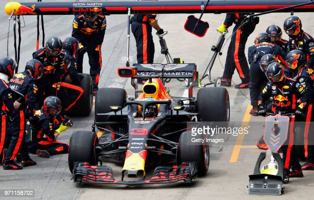 Daniel Ricciardo of Australia driving the Aston Martin Red Bull Racing RB14 TAG Heuer makes a pitstop for new tyres during the Canadian Formula One...