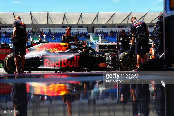 Daniel Ricciardo of Australia driving the Aston Martin Red Bull Racing RB14 TAG Heuer stops outside his garage during practice for the Formula One...