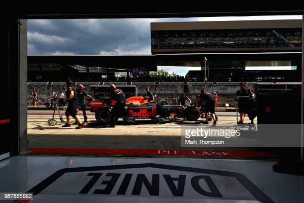 Daniel Ricciardo of Australia driving the Aston Martin Red Bull Racing RB14 TAG Heuer stops in the Pitlane during qualifying for the Formula One...