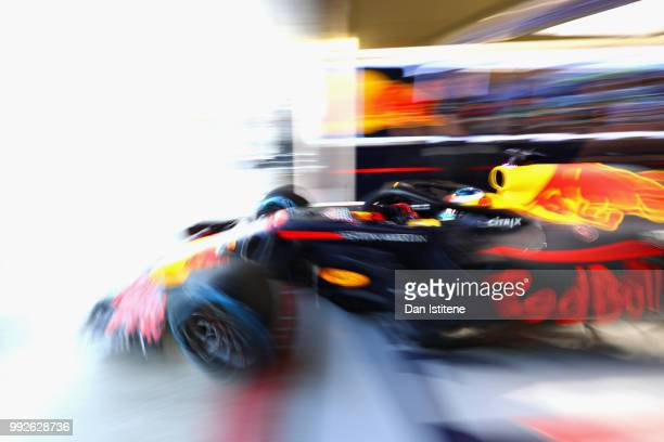Daniel Ricciardo of Australia driving the Aston Martin Red Bull Racing RB14 TAG Heuer leaves the garage during practice for the Formula One Grand...
