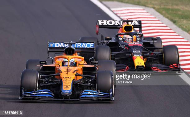 Daniel Ricciardo of Australia driving the McLaren F1 Team MCL35M Mercedes leads Max Verstappen of the Netherlands driving the Red Bull Racing RB16B...