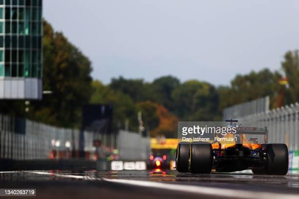 Daniel Ricciardo of Australia driving the McLaren F1 Team MCL35M Mercedes to the grid before the F1 Grand Prix of Italy at Autodromo di Monza on...