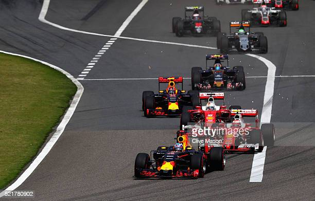 Daniel Ricciardo of Australia driving the Red Bull Racing Red BullTAG Heuer RB12 TAG Heuer leads Kimi Raikkonen of Finland driving the Scuderia...