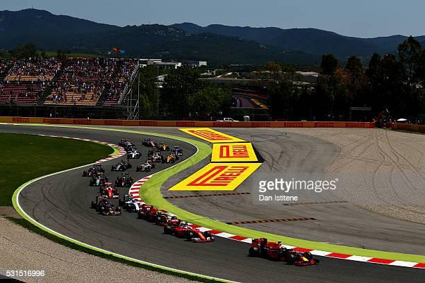 Daniel Ricciardo of Australia driving the Red Bull Racing Red Bull-TAG Heuer RB12 TAG Heuer ahead of Sebastian Vettel of Germany driving the Scuderia...