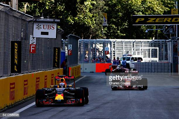 Daniel Ricciardo of Australia driving the Red Bull Racing Red BullTAG Heuer RB12 TAG Heuer leads Sebastian Vettel of Germany driving the Scuderia...