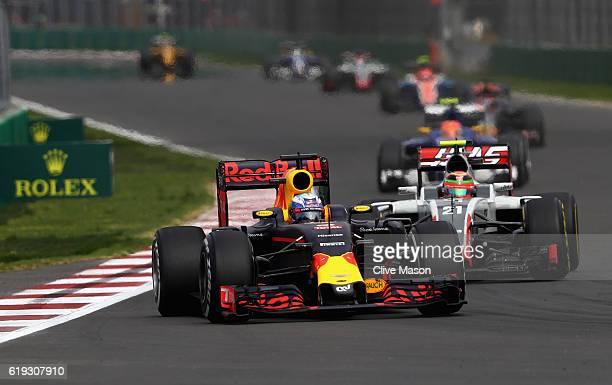 Daniel Ricciardo of Australia driving the Red Bull Racing Red BullTAG Heuer RB12 TAG Heuer leads Esteban Gutierrez of Mexico driving the Haas F1 Team...
