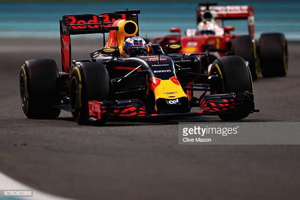 Daniel Ricciardo of Australia driving the Red Bull Racing Red Bull-TAG Heuer RB12 TAG Heuer leads Sebastian Vettel of Germany driving the Scuderia...