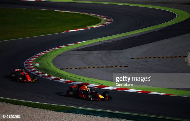 Daniel Ricciardo of Australia driving the Red Bull Racing Red BullTAG Heuer RB13 TAG Heuer leads Sebastian Vettel of Germany driving the Scuderia...