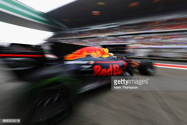 Daniel Ricciardo of Australia driving the Red Bull Racing Red BullTAG Heuer RB13 TAG Heuer leaves the garage for the grid during the Formula One...